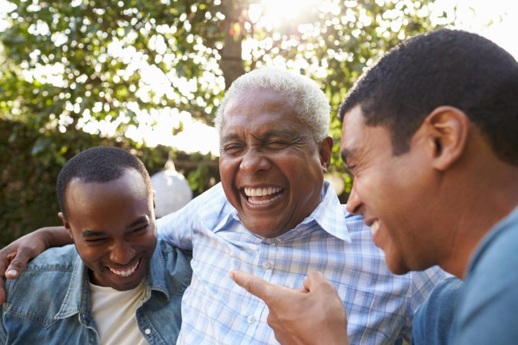 The Landing at Queensbury | Senior man laughing with family