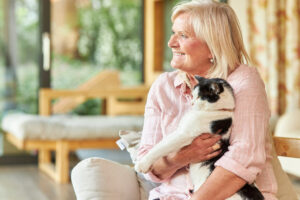 Pegasus Senior Living | Senior woman holding cat