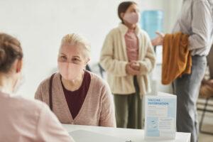 Pegasus Senior Living | Seniors read to receive their vaccines