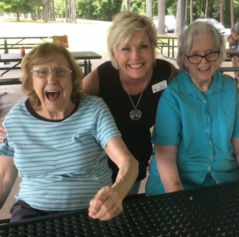The Renaissance of Florence   Associate Sharon outdoors with residents
