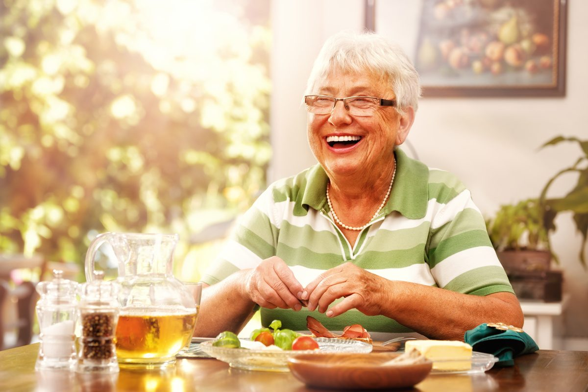 The Rivers at Puyallup | Happy senior woman eating breakfast