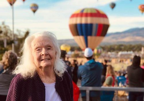 The Seasons of Reno | Resident in front of air balloons