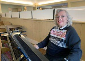 The Village at Rancho Solano | Senior woman playing piano