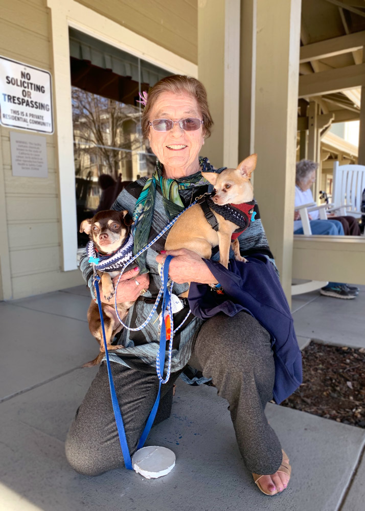 The Village at Rancho Solano | Resident holding dogs