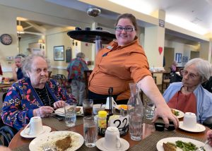The Village at Rancho Solano | Seniors served by associate at table
