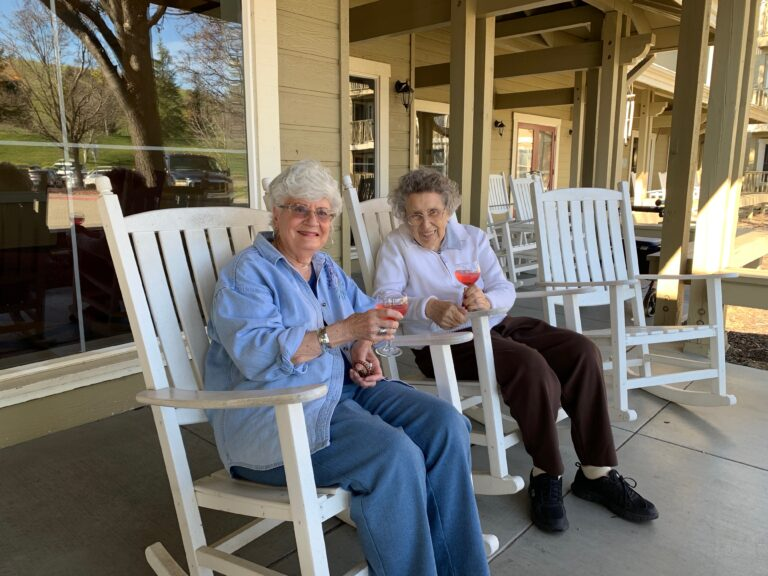 The Village at Rancho Solano | Residents sitting on porch