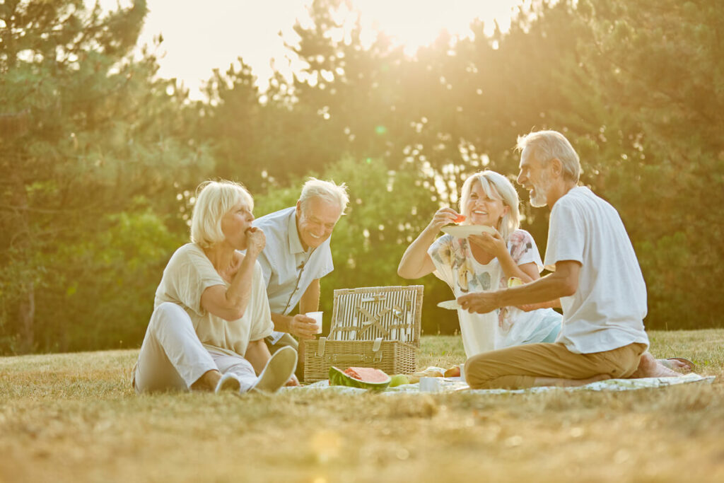 Town Village Crossing | Group of seniors picnicking