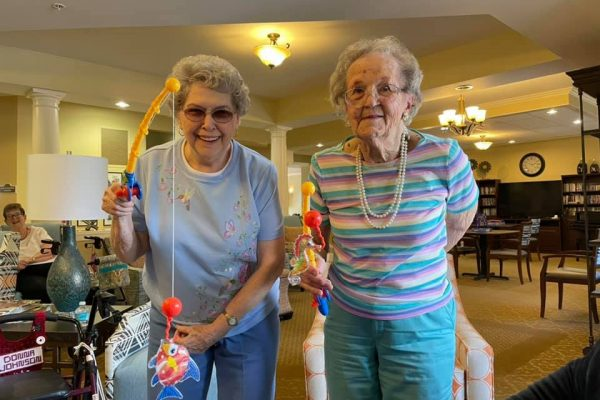 Whispering Winds of Apple Valley | Seniors playing with fishing crafts