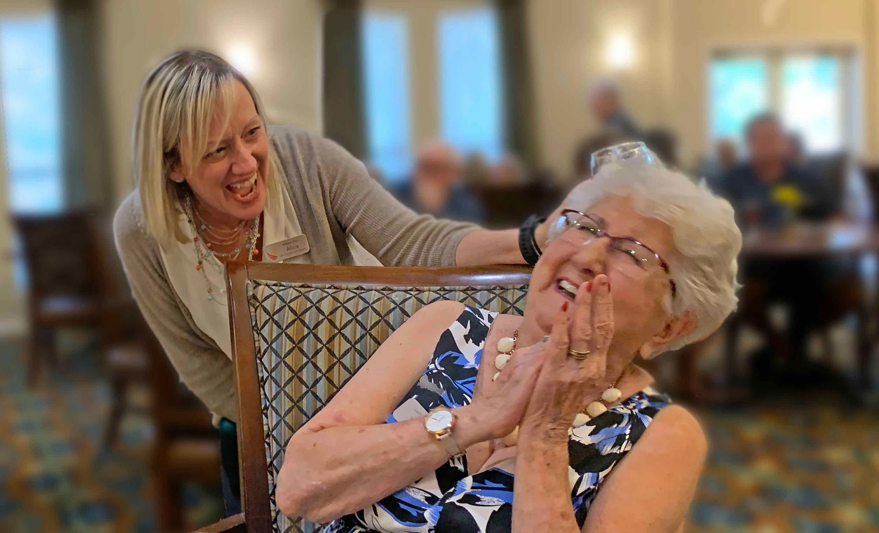 senior woman and adult daughter laughing
