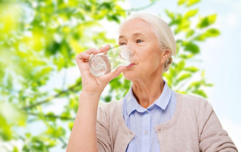 Pegasus Senior Living | Senior woman drinking water