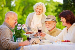 Pegasus Senior Living | Seniors eating dinner outdoors