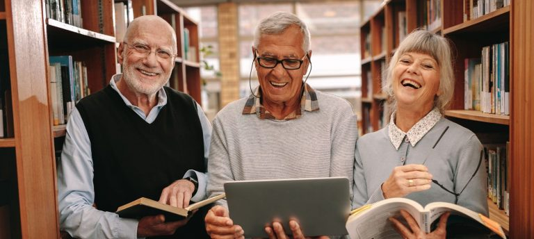 Pegasus Senior Living | Seniors in library