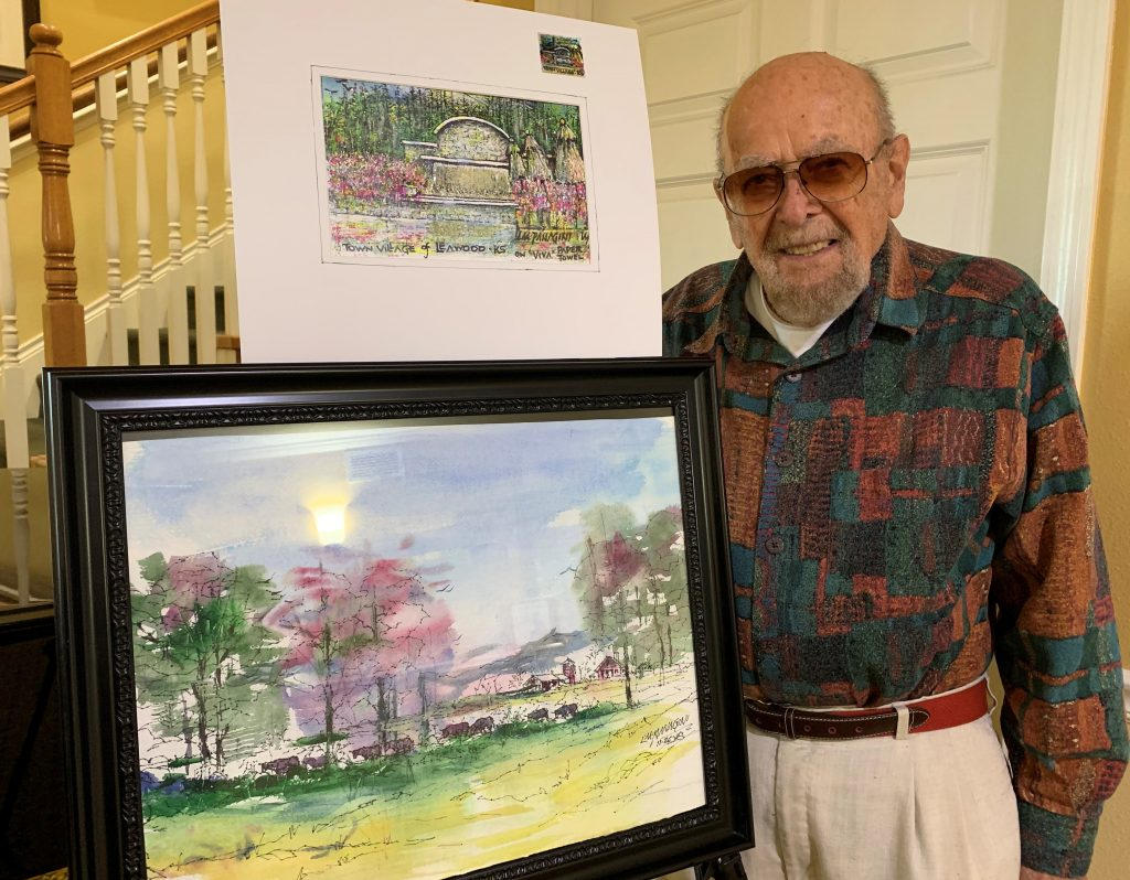 Pegasus Senior Living | Louis and his painting at Town Village of Leawood