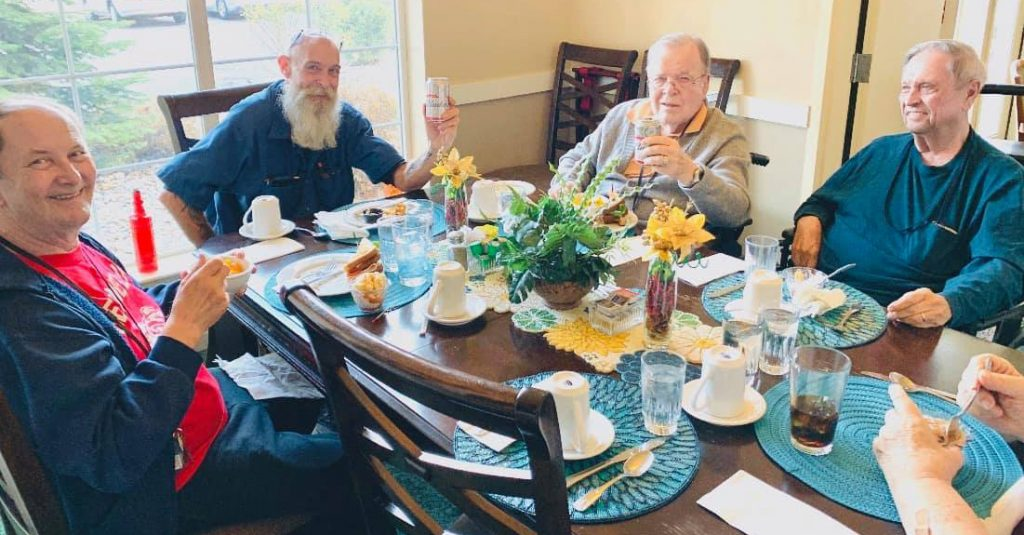 Pegasus Senior Living | Senior men at table