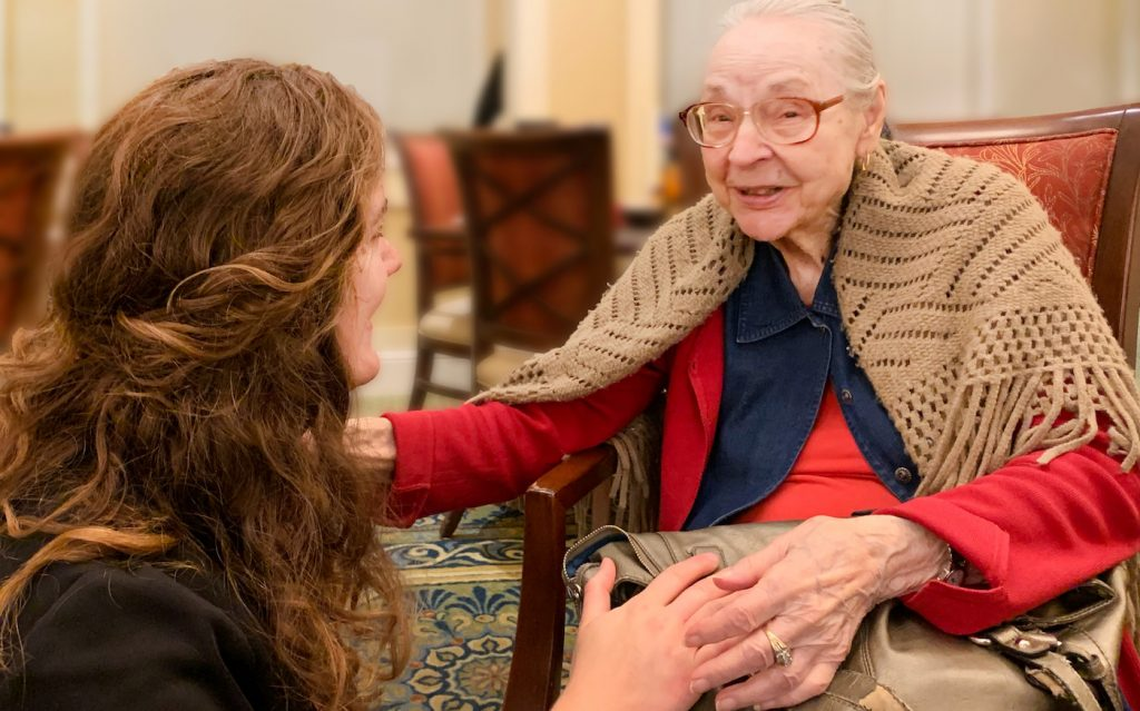 Pegasus Senior Living | Resident speaking to associate