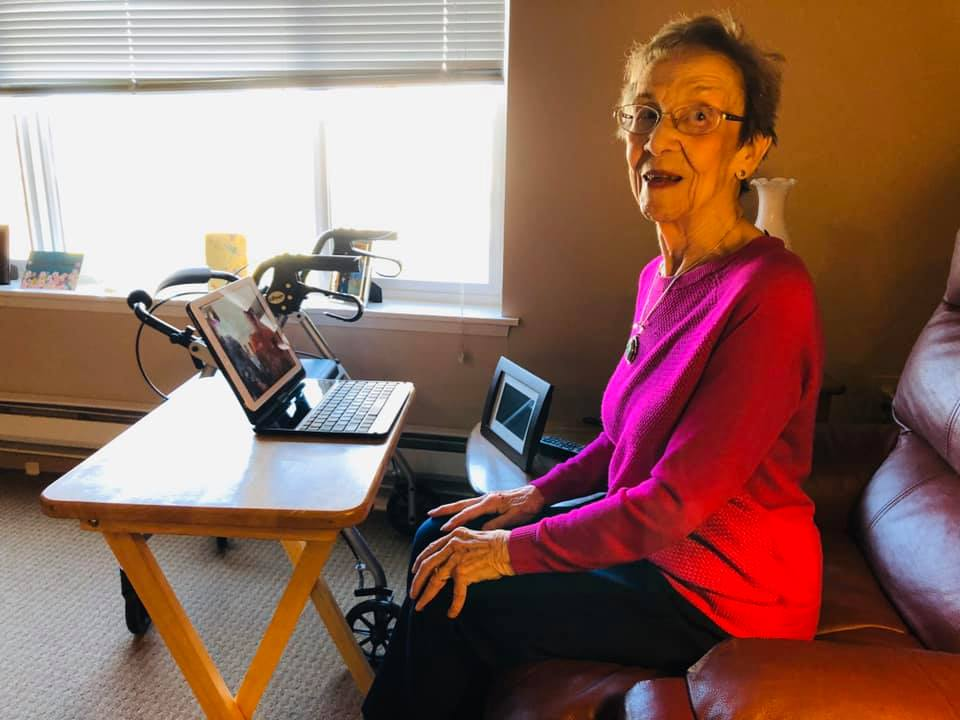 Pegasus Senior Living resident video chatting with family
