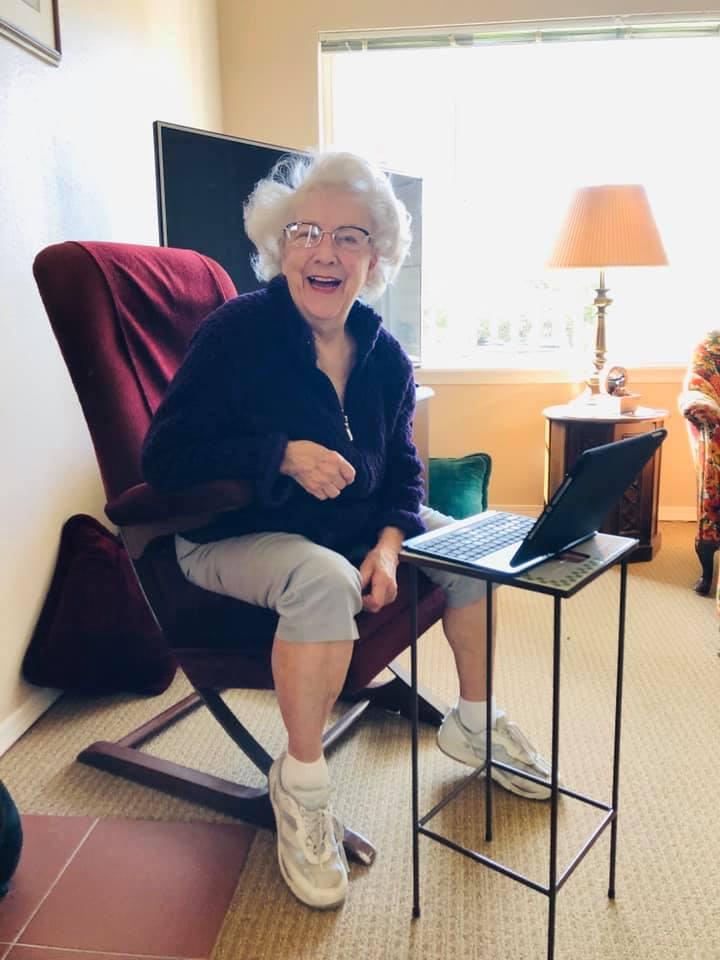 Pegasus Senior Living | Resident video chatting with family