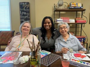 senior living residents enjoying painting activity