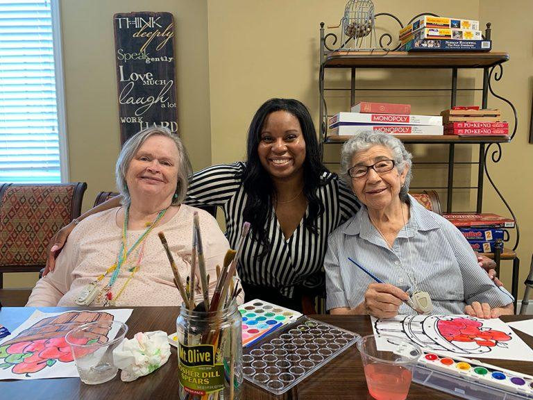 senior living residents enjoying painting activity