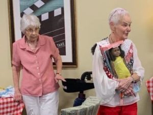 Beverly and Barbara making doll clothes at Broadway Mesa Village in Mesa, AZ