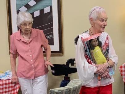 Pegasus Senior Living   Beverly and Barbara making doll clothes at Broadway Mesa Village in Mesa, AZ