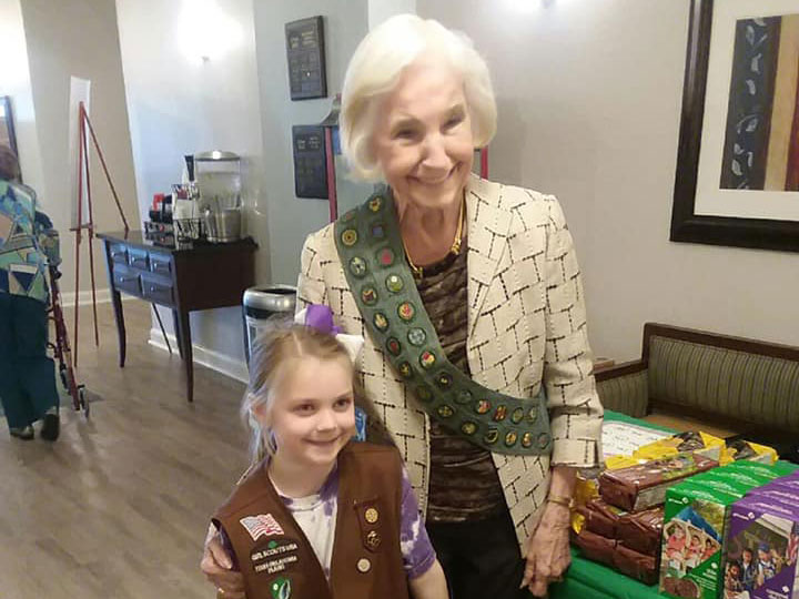 Pegasus Senior Living | Resident Shirley and girl scout at Ridgmar Place independent living in Fort Worth, TX
