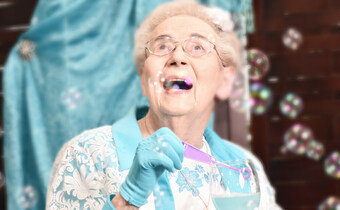 Pegasus Senior Living | Resident blowing bubbles