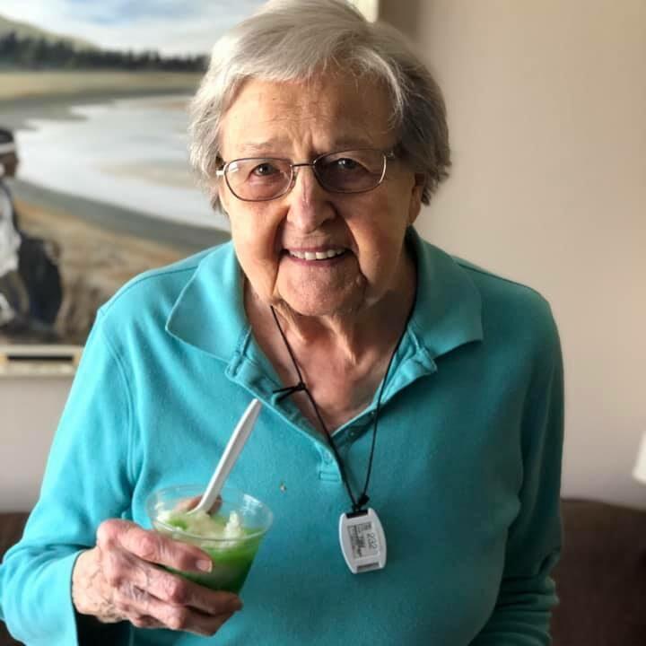 Pegasus Senior Living | Resident with drink