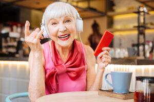 Pegasus Senior Living   Cheerful positive woman enjoying rock music