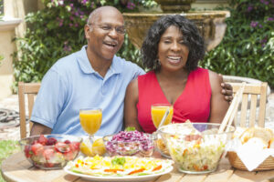 Pegasus Senior Living | Senior couple eating outside
