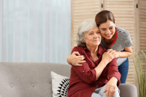 Pegasus Senior Living | Elderly woman with female caregiver in living room