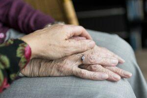 Pegasus Senior Living   Senior holding hands with caregiver