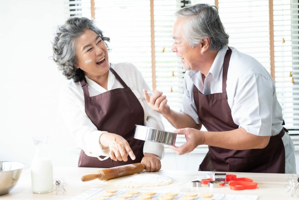 Pegasus Senior Living | Senior couple baking in kitchen