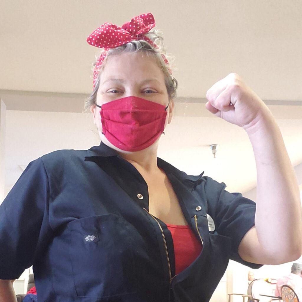 Pegasus Senior Living | Woman Flexing in Mask