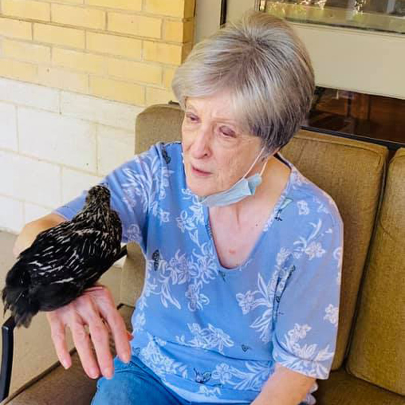 Pegasus Senior Living | Senior woman holding chick