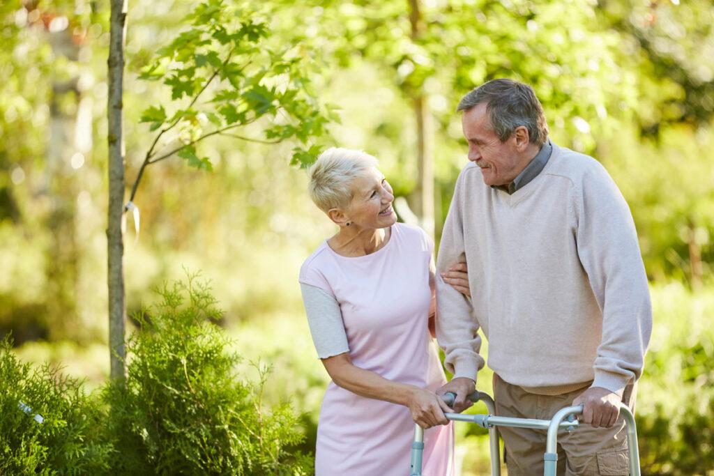 Elk Grove Park | Caregiver helping senior walk