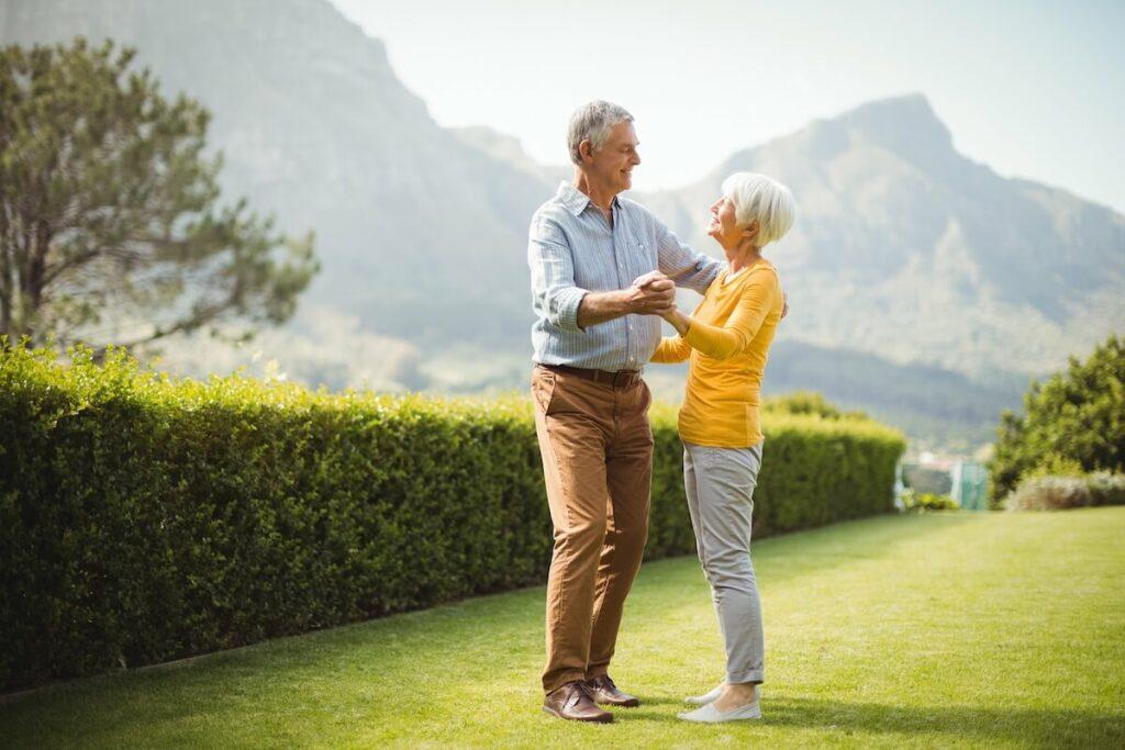Pegasus Senior Living | Senior couple dancing outside with mountain views