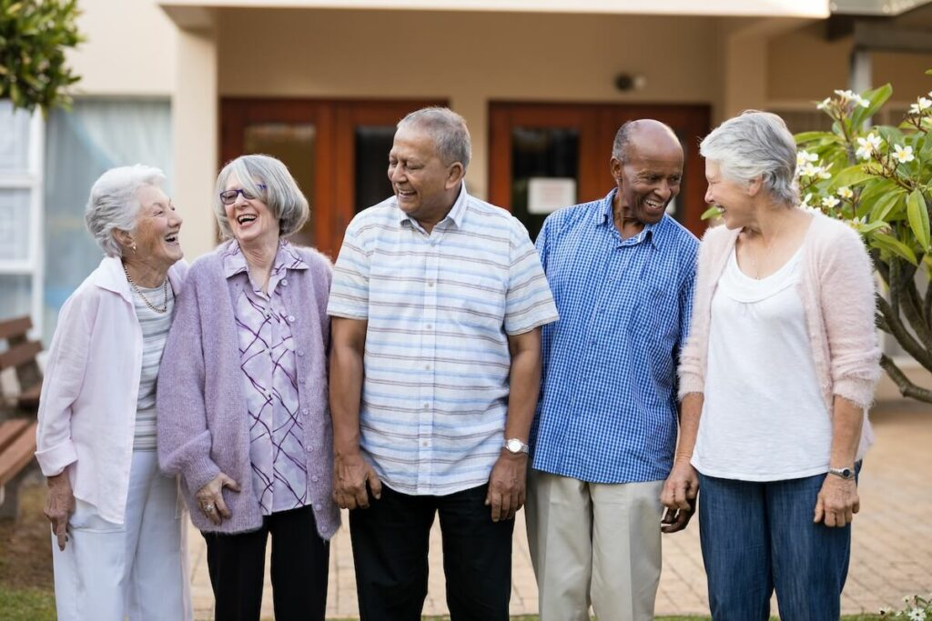 Sterling Court at Roseville | Group of seniors standing in community courtyard