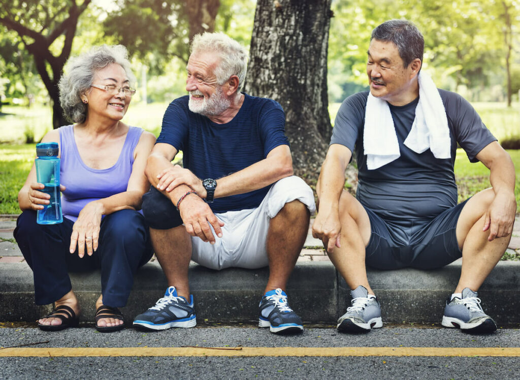The Village at Rancho Solano | Seniors resting after exercise outdoors