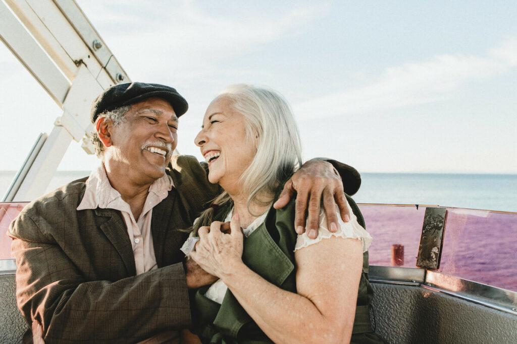 Sterling Court at Roseville | Senior couple riding a ferris wheel